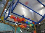 balls falling from the hopper -- Ball Factory, San Antonio Children's Museum