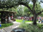 Gathering at the faux bois Valero Pavilion by Carlos Cortes -- Monte Vista 4th of July parade at Landa Library in 2010
