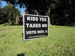 Kids Yes Taxes No San Antonio Tea Party anti Pre-K 4 SA sign full day early childhood education preschool san antonio Julian Castro brainpower initiative