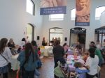 Families doing crafts at the San Antonio Museum of Art to celebrate two new books in the Arte Kids series from Trinity University Press
