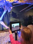 Omeisaurus skeleton and 3D tablet in Dinosaurs Unearthed at Witte Museum in San Antonio Texas