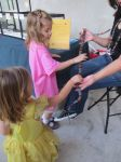 San Antonio Botanical Garden BOOtanica! Fall Festival 2013 girls touching snake | San Antonio Charter Moms