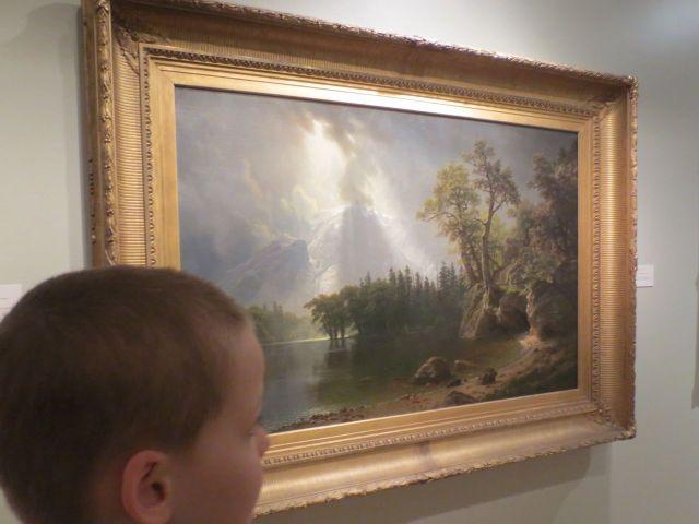 "F.T. looking at Albert Bierstadt's ""Passing Storm over the Sierra Nevadas"" (1870) at San Antonio Museum of Art | San Antonio Charter Moms"