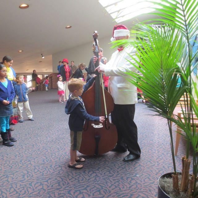 Cello at the Instrument Petting Zoo - San Antonio Symphony family concert   San Antonio Charter Moms