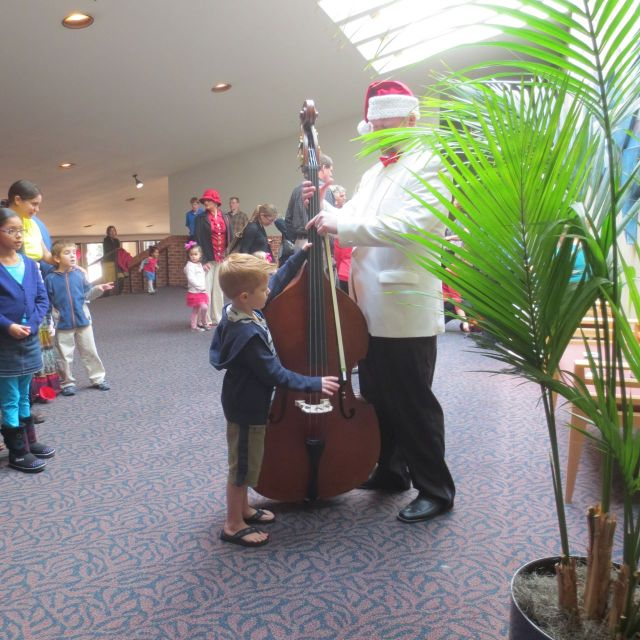 Cello at the Instrument Petting Zoo - San Antonio Symphony family concert | San Antonio Charter Moms