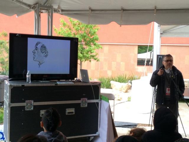 Joe Cepeda with sketch of Cesar Chavez - San Antonio Book Festival | San Antonio Charter Moms