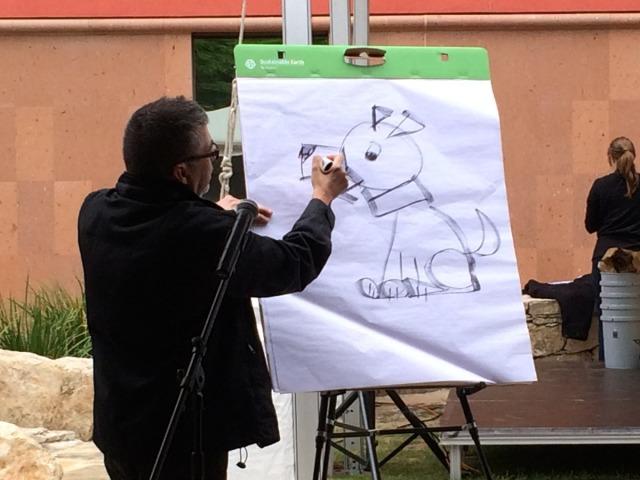 Joe Cepeda sketching a dog at the San Antonio Book Festival | San Antonio Charter Moms