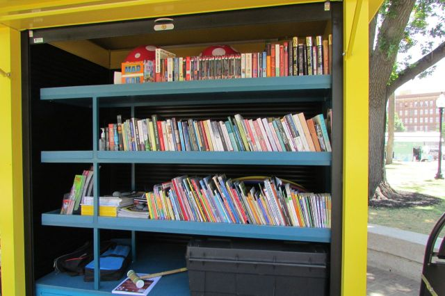 Borrow books, games, and toys from the kiosk at Travis Park, downtown San Antonio | San Antonio Charter Moms