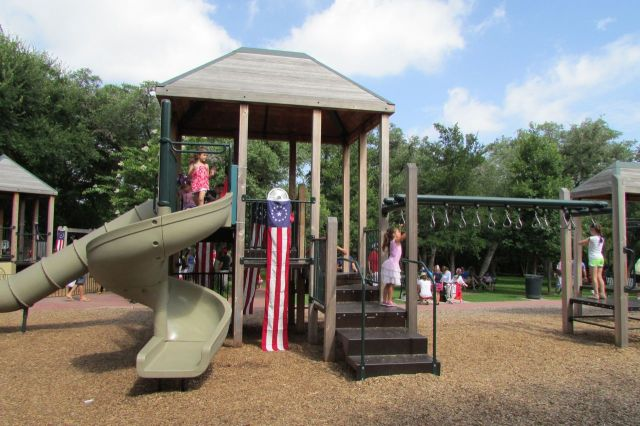 Patriotic playground decorations at the Monte Vista Historical Association 4th of July picnic | San Antonio Charter Moms