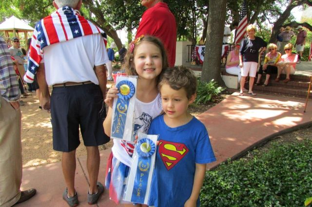Sophia and Lucas Rico with first place ribbons for best decorated bikes at the Monte Vista Historical Association 4th of July parade and picnic | San Antonio Charter Moms