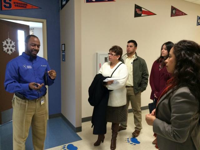 Principal Curtis Lawrence leading SBOE Marisa B. Perez and family on a tour of IDEA Monterey Park | San Antonio Charter Moms