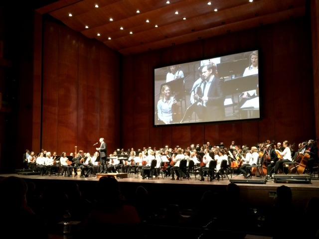 Sebastian Lang-Lessing addressing the audience at a San Antonio Symphony DISCOVER Series concert in the H-E-B Performance Hall of the Tobin Center for the Performing Arts | San Antonio Charter Moms