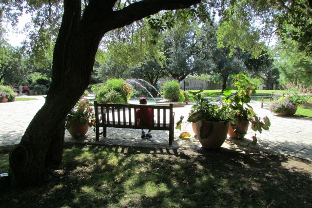 Sitting on a bench at the Fountain Plaza of the San Antonio Botanical Garden | San Antonio Charter Moms
