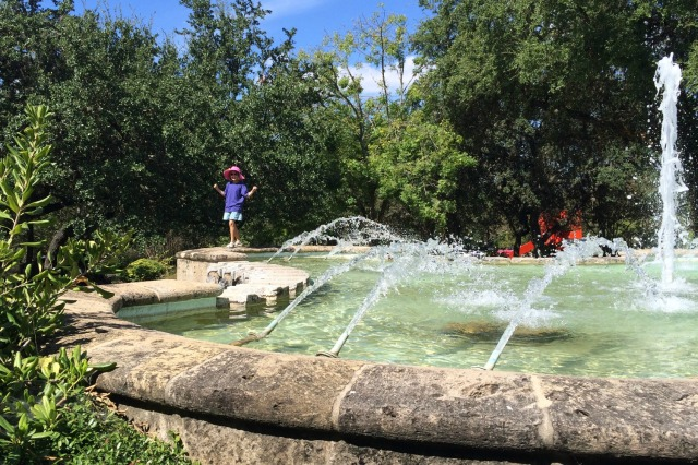 Playing at the fountain on the grounds of the McNay Art Museum | San Antonio Charter Moms