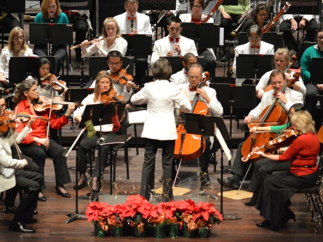 Akiko Fujimoto conducting San Antonio Symphony Holiday Pops at the Tobin Center | San Antonio Charter Moms